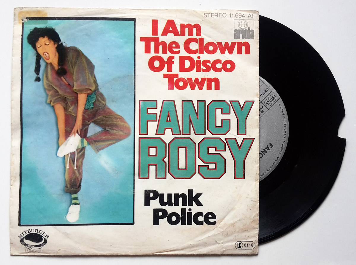 Fancy Rosy punk police / I am the clown of the disco town